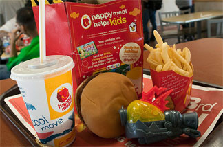 The promise of the latest toy is a big allure for kids at McDonald's