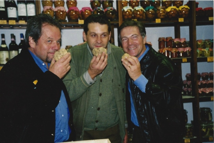 Old friends Wolfgang Puck (left) and Piero Selvaggio (right) sampling truffles (and mugging) with an unknown truffle merchant.
