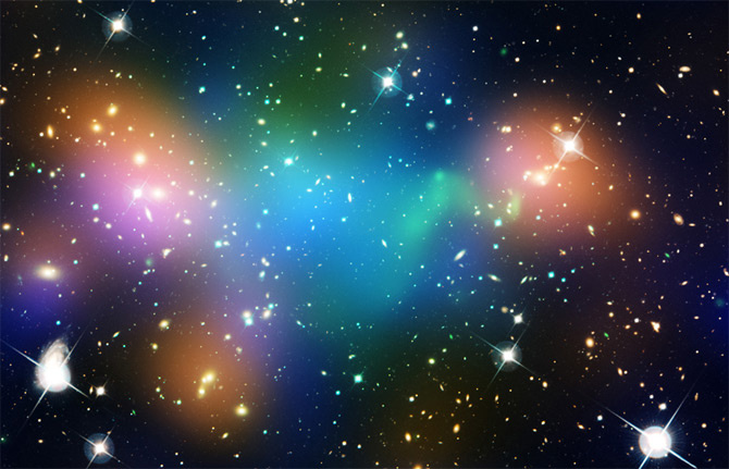 "This composite image shows the distribution of dark matter, galaxies, and hot gas in the core of the merging galaxy cluster Abell 520, formed from a violent collision of massive galaxy clusters.  The natural-color image of the galaxies was taken with NASA's Hubble Space Telescope and with the Canada-France-Hawaii Telescope in Hawaii.  Superimposed on the image are ""false-colored"" maps showing the concentration of starlight, hot gas, and dark matter in the cluster. Starlight from galaxies, derived from observations by the Canada-France-Hawaii Telescope, is colored orange. The green-tinted regions show hot gas, as detected by NASA's Chandra X-ray Observatory. The gas is evidence that a collision took place. The blue-colored areas pinpoint the location of most of the mass in the cluster, which is dominated by dark matter. Dark matter is an invisible substance that makes up most of the universe's mass. The dark-matter map was derived from the Hubble Wide Field Planetary Camera 2 observations by detecting how light from distant objects is distorted by the cluster of galaxies, an effect called gravitational lensing.  The blend of blue and green in the center of the image reveals that a clump of dark matter resides near most of the hot gas, where very few galaxies are found. This finding confirms previous observations of a dark-matter core in the cluster. The result could present a challenge to basic theories of dark matter, which predict that galaxies should be anchored to dark matter, even during the shock of a collision.  Abell 520 resides 2.4 billion light-years away."