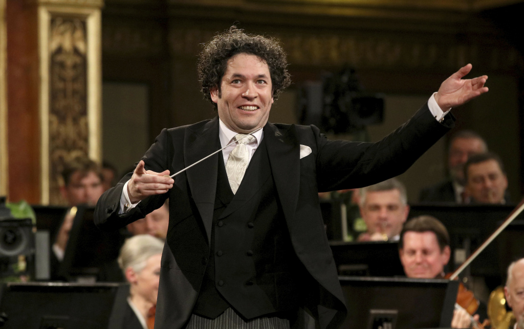 File: In this Jan. 1, 2017 file photo, Maestro Gustavo Dudamel, of Venezuela, conducts the Vienna Philharmonic Orchestra during the traditional New Year's Concert at the Golden Hall of the Musikverein in Vienna, Austria. Dudamel spoke out against the Venezuelan government he has long performed for over its bloody crackdown on protesters in a statement after the May 3, 2017 death of 17-year-old Armando Canizales at a demonstration. Canizales was reportedly a member of the government-financed El Sistema musical education program that gave rise to Dudamel's career. (AP Photo/Ronald Zak, File)