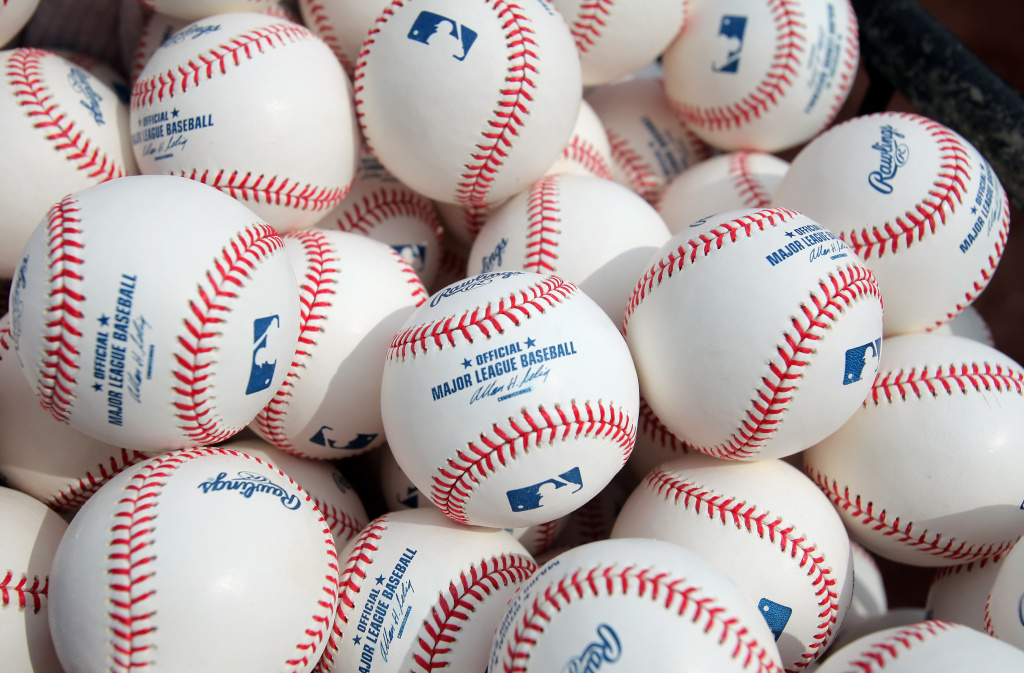 Baseballs are at the ready for warm ups as the Philadelphia Phillies face the Colorado Rockies during MLB action on Opening Day at Coors Field on April 10, 2009 in Denver, Colorado.