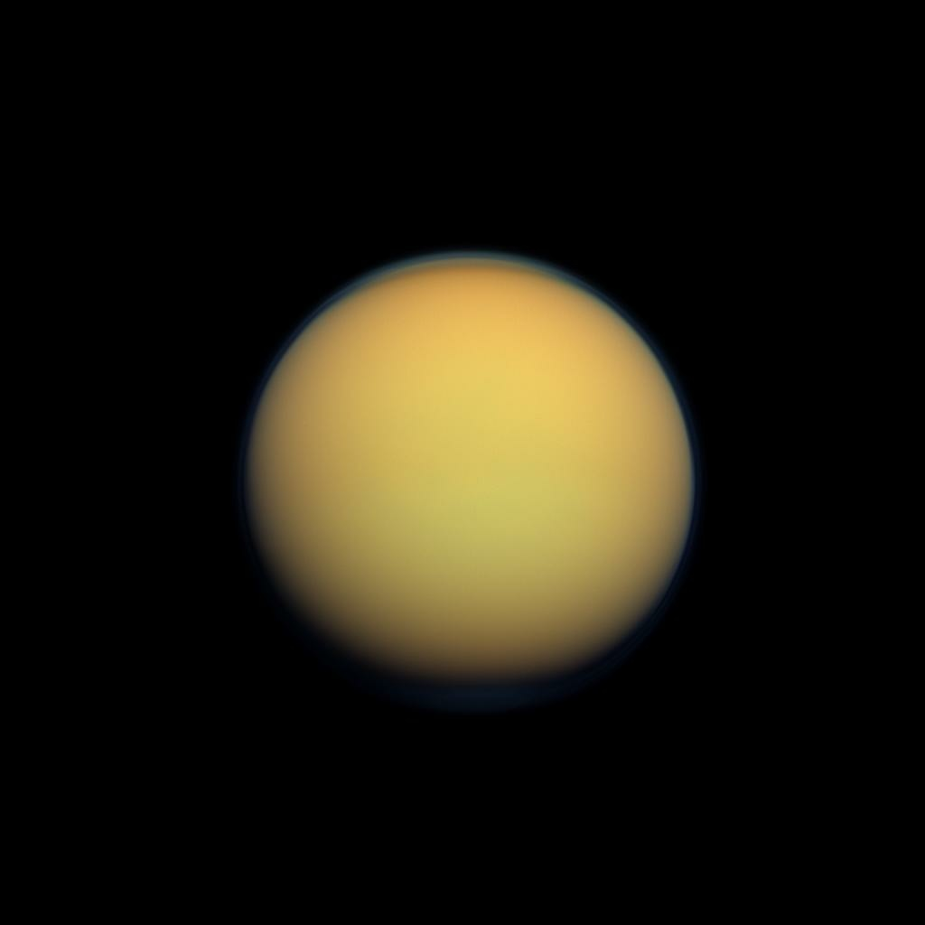 Titan's atmosphere, made up of mostly methane and nitrogen, surrounds Saturn's largest moon with an orange haze.