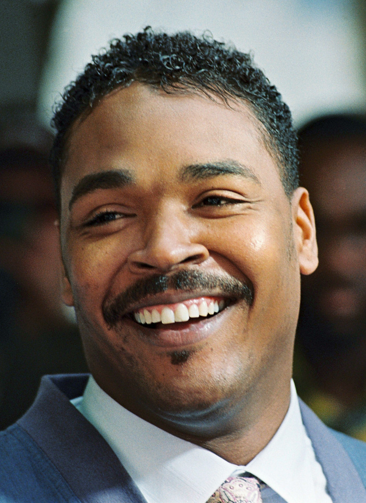 Rodney King, the Los Angeles motorist whose beating by police was captured on videotape and subsequent acquittal of the officers led to widespread deadly riots, smiles in Beverly Hills, during a press conference.