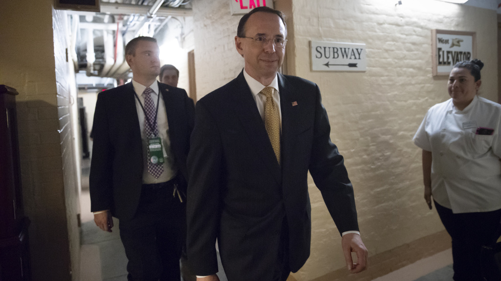 Deputy Attorney General Rod Rosenstein departs the U.S. Capitol through a basement corridor after House and Senate lawmakers from both parties met for a classified briefing in a secure room about the federal investigation into President Donald Trump's 2016 campaign on May 24, 2018.