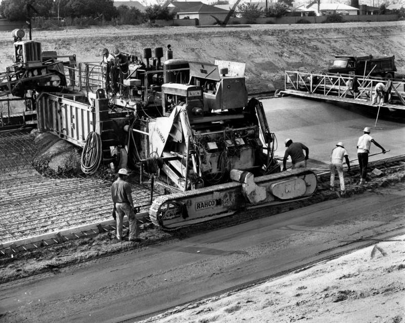 A crew of men are seen paving the main channel, San Gabriel's water flood control project. It is near Whittier Narrows and is part of the county's multi-million dollar effort to prevent inundations. Photo dated: November 8, 1965.