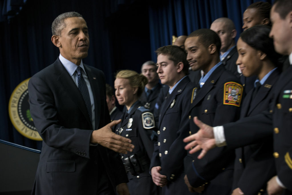 U.S. President Barack Obama greets emergency responders after speaking about the sequester in the Eisenhower Executive Office Building on the White House campus February 19, 2013 in Washington, DC.