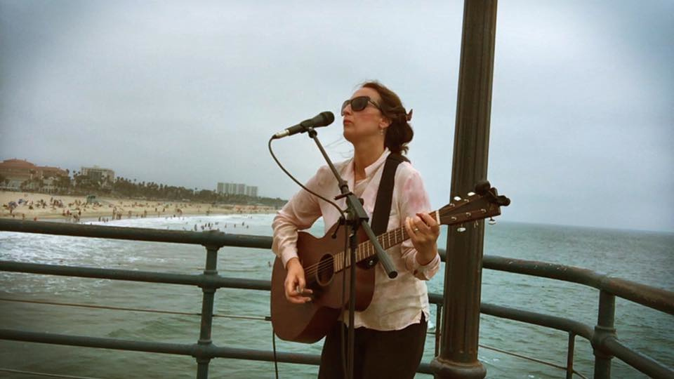 KPCC listener and musician Cynthia Brando busks on the shoreline of Los Angeles.