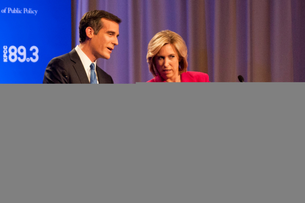 City Councilman Eric Garcetti and City Controller Wendy Greuel check the time, minutes before a 7 p.m. mayoral debate at USC Health Sciences Campus in Mayer Auditorium on Monday.
