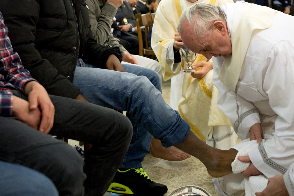 In this photo provided by the Vatican newspaper L'Osservatore Romano, Pope Francis washes the foot of an inmate at the juvenile detention center of Casal del Marmo, Rome, Thursday, March 28, 2013. Francis washed the feet of a dozen inmates at a juvenile detention center in a Holy Thursday ritual that he celebrated for years as archbishop and is continuing now that he is pope. (AP Photo/L'Osservatore Romano, ho)