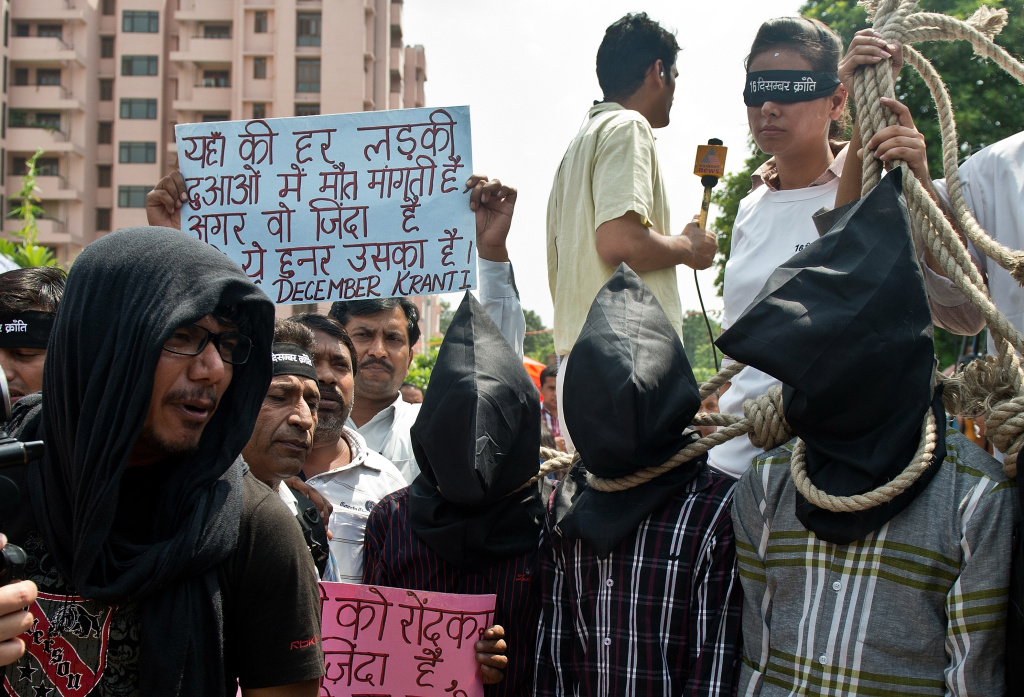 Indian youth protest outside the Saket Court complex in New Delhi on September 10, 2013. An Indian court convicted four men of the gang rape and murder of a physiotherapy student on board a moving bus in a crime that sickened the nation.