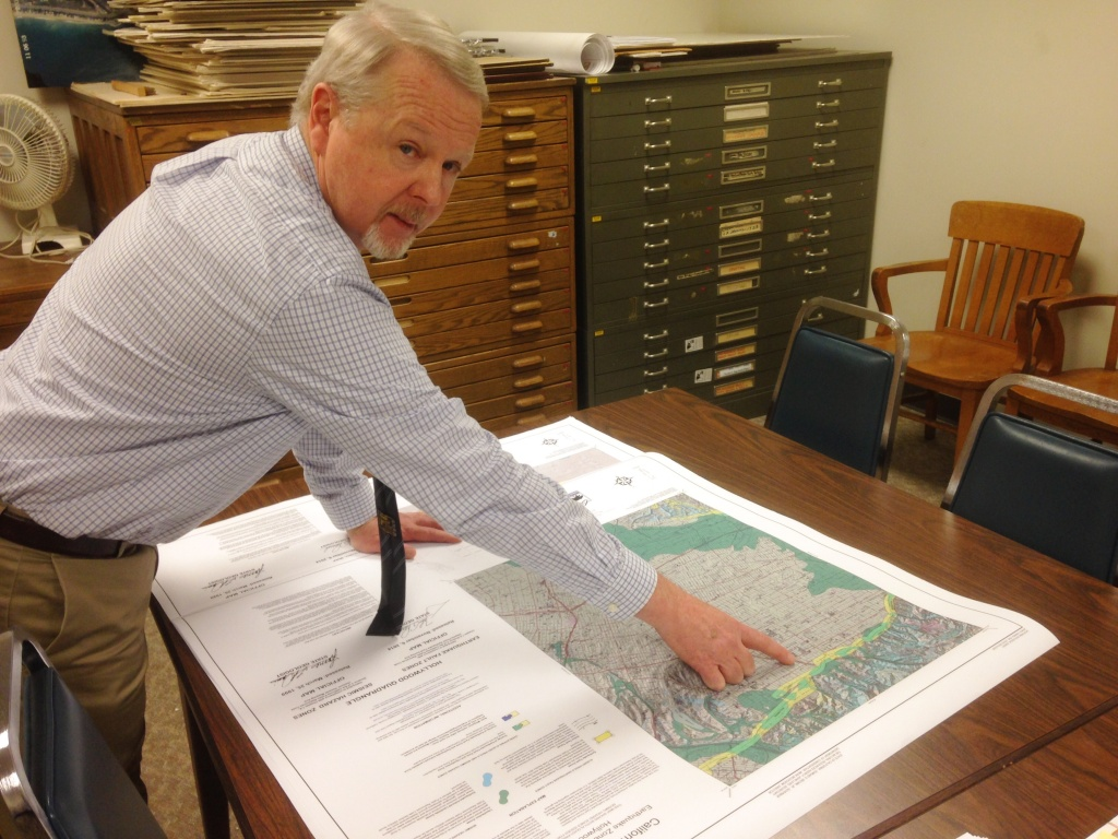 California Geological Survey's Tim McCrink pointing to the location of the Hollywood fault on the newly released map.