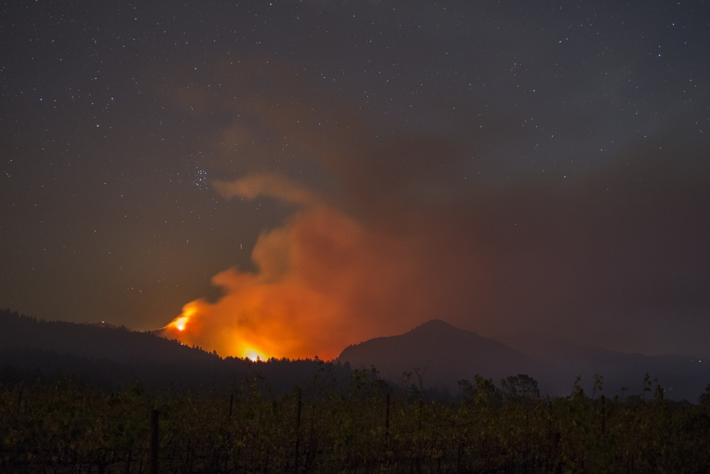 The Nuns Fire burns through the night on October 14, 2017 near Kenwood and Santa Rosa in Northern California.