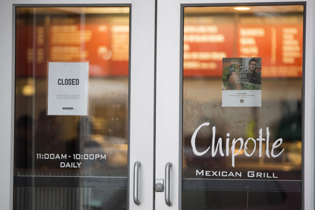 A sign showing that the Chipotle Mexican Grill seen at 1924 Beacon St. is closed on December 8, 2015 in Boston, Massachusetts.