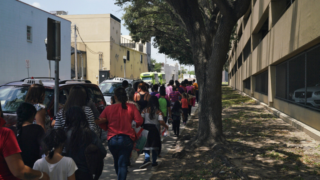 Women and children walk to a bus in McAllen, Texas. People released from immigration detention centers are often dropped off at the McAllen bus station in the Rio Grande Valley.