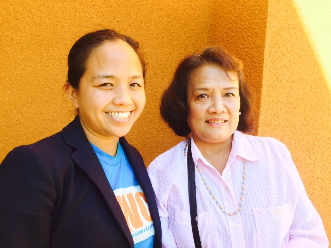 Aquilina Soriano, left, executive director of the Pilipino Workers Center, and Leah Tejada, right, whose family in the Philippines is still feeling the effects from Typhoon Haiyan one year ago.