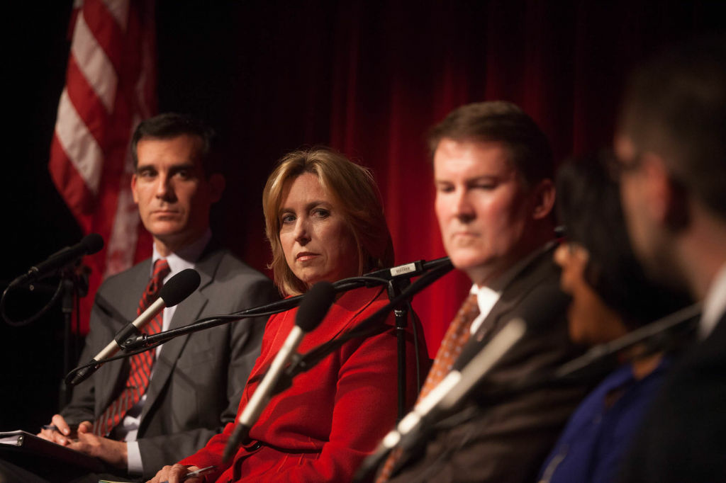 Mayoral candidate and LA City Controller Wendy Greuel sits next to her main rival in the campaign, councilman Eric Garcetti.