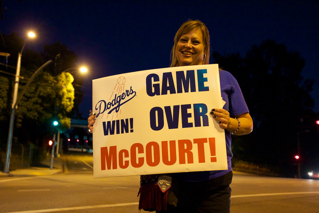 Kristie Wold from Downey, CA celebrated McCourt's decision to part with the Dodgers on Wednesday, November 2, 2011.