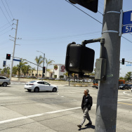 A pedestrian crosses a section of Rodeo Road that will be renamed Obama Boulevard in honor of former President Barack Obama, on Wednesday, June 28, 2017, in Los Angeles. The Los Angeles City Council has voted unanimously to name a street for former President Obama. The motion approved 14-0 Wednesday calls for the city engineer to begin the process of renaming several miles of Rodeo Road as Obama Boulevard. (AP Photo/Chris Pizzello)