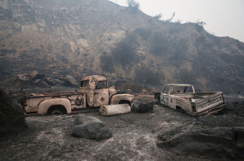 Old cars sit amid a landscaped charred by the Thomas Fire near Ojai, California (December 8, 2017).