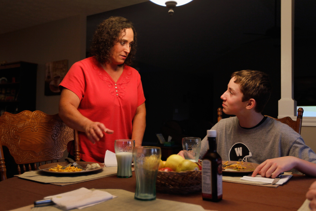 Dawn Gunkel (R) and her son, Parker Gunkel,12, during their family dinner on March 1, 2012 in Wilmington, Ohio.