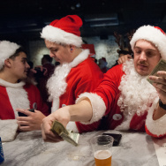 Men dressed as a Santa drink at a bar called The Hall during the annual SantaCon pub crawl December 12, 2015 in the Brooklyn borough of New York City.