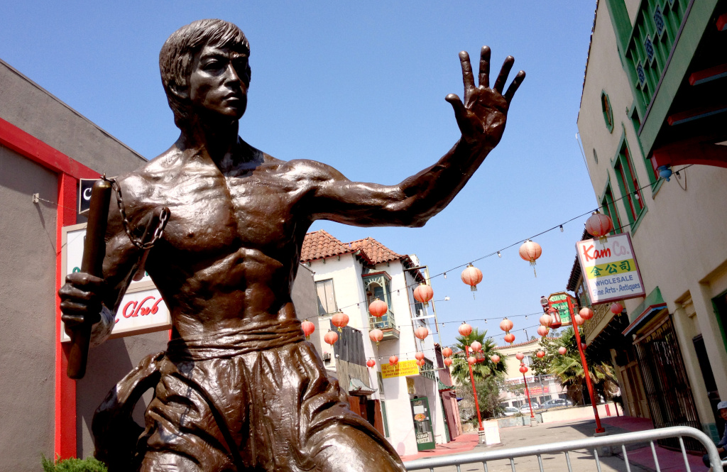 A bronze statue of martial arts legend Bruce Lee was unveiled temporarily in L.A.'s Chinatown as its backers hope to bring in additional funding to make it permanent.