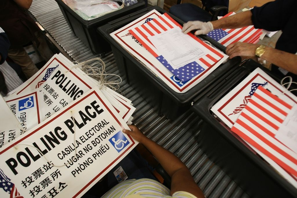 Workers at the Los Angeles County Registrar-Recorder County Elections Operations Center pack materials to be delivered to polling places for a previous election.