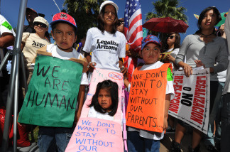 Members of the Aguila family join others to demonstrate against Arizona's tough new immigration laws at a large rally in Phoenix on May 29, 2010.