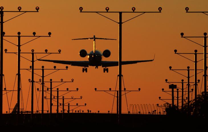US-CRIME-SHOOTING-AIRPORT lax plane landing takeoff runway orange