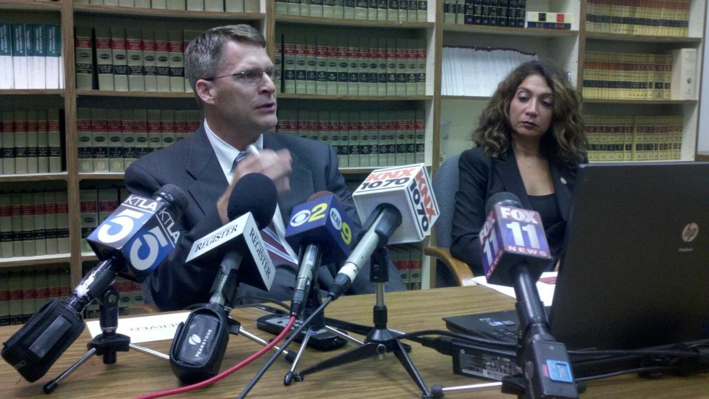 Dan Wagner, Assistant District Attorney, and Susan A. Price, Senior Deputy District Attorney, speaking at the OC District Attorney Office. The District Attorney has cleared an OC Sheriff's Deputy of wrongdoing in the February shooting death of Manuel Loggins in San Clemente. Photo: Ben Bergman/KPCC