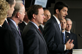 Flanked by other congressionial members, U.S. Rep. Paul Ryan (R-WI), chairman of the House Budget Committee, speaks during a news conference April 5, 2011 on Capitol Hill in Washington, DC. House Republicans have unveiled their version of the budget proposal for FY 2012 which would cut government spending $6.2 tillion more in 10 years than the version by the Obama Administration.