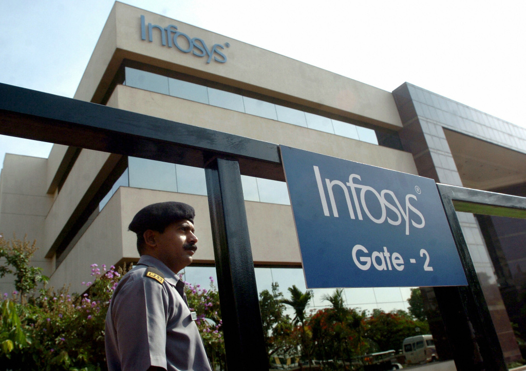 A security guard stands at an entrance gate of India software giant Infosys Technologies in Bangalore, India in 2005.