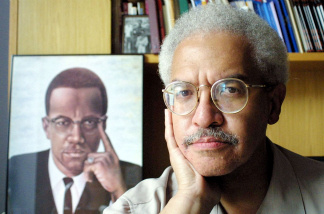 Manning Marable, Director of the Institute of African American Studies at Columbia University, poses for a photograph in his office August 16, 2001 in New York City.