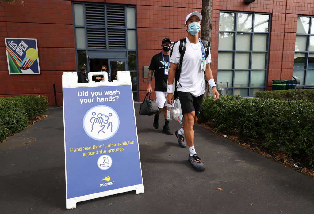 A player wears a face covering as he walks the grounds on Day One of the 2020 US Open at the USTA Billie Jean King National Tennis Center on August 31, 2020 in the Queens borough of New York City.