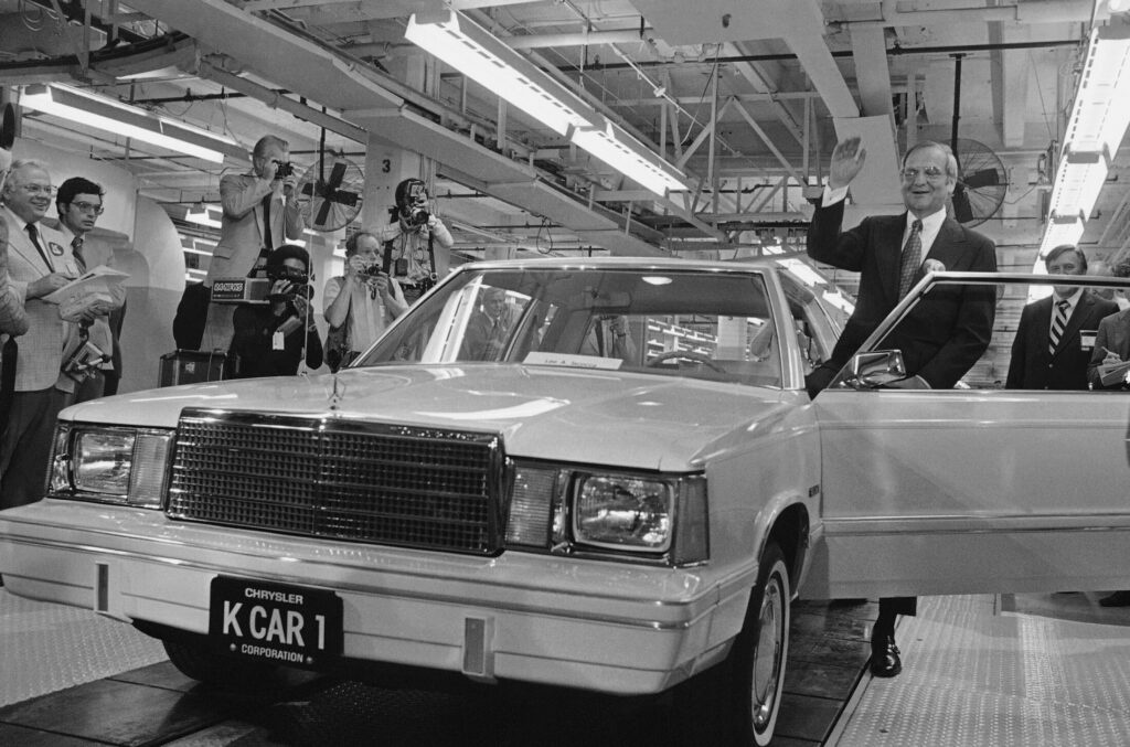 Chrysler Chairman Lee Iacocca steps into the first K-Car in Detroit, Mich., on Aug. 6, 1980.