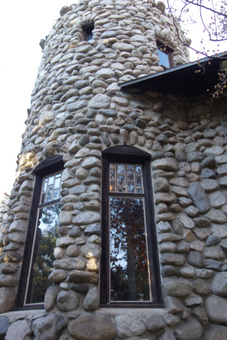 The curved wall was inspired by the missions Charles Lummis saw in California.