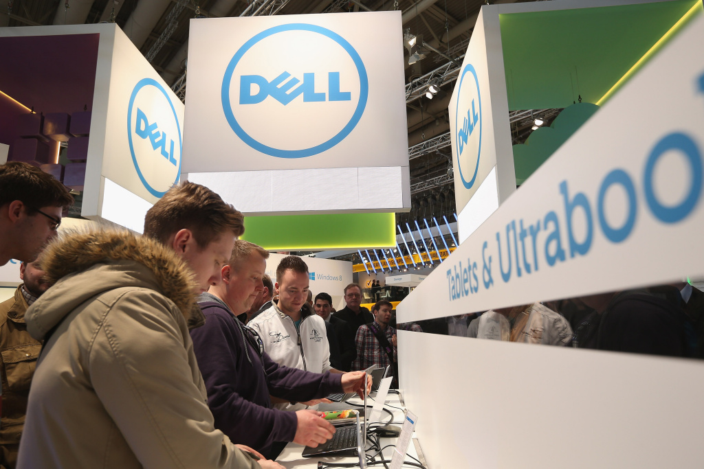 Visitors try out the latest laptop computers at the Dell stand at the 2013 CeBIT technology trade fair on March 5, 2013 in Hanover, Germany. CeBIT will be open March 5-9.