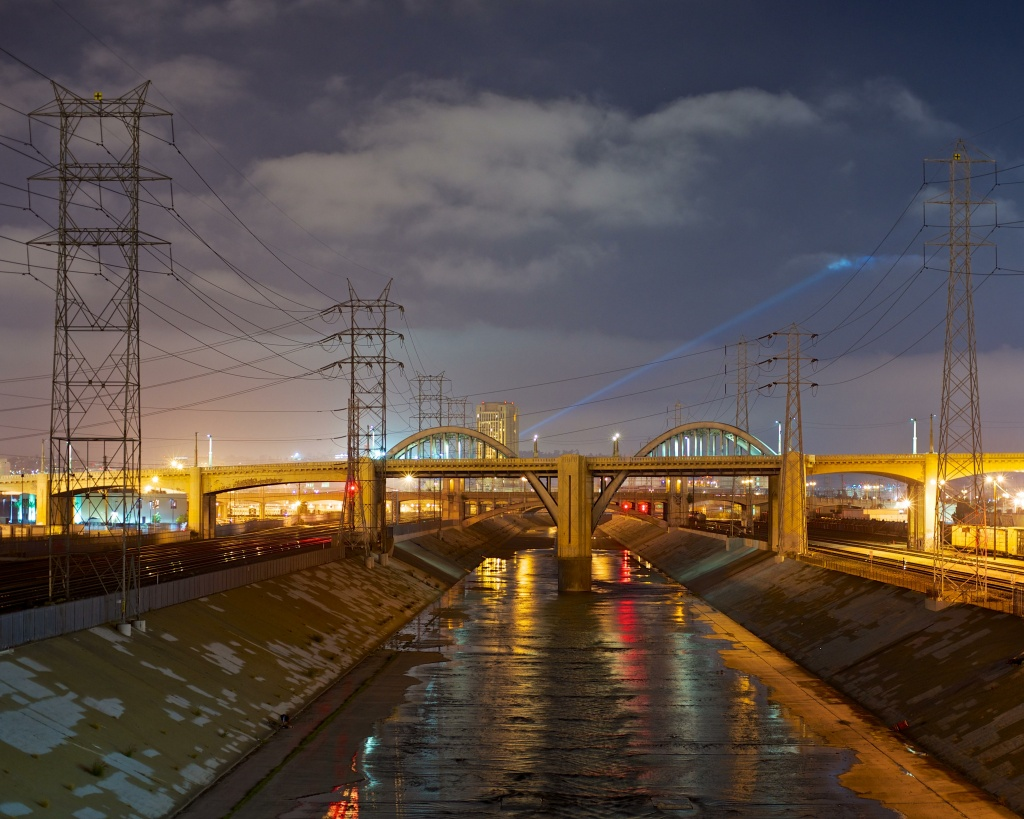 This Creative Commons photo shows the Los Angeles River from the 7th street bridge, looking NNW.