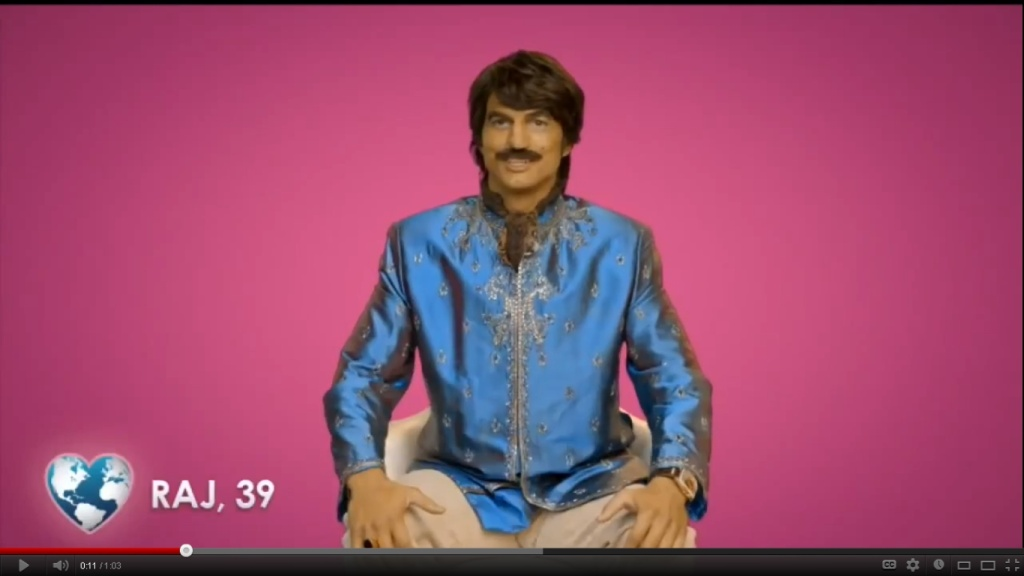 A screen grab from a commercial for Popchips, shows Ashton Kutcher playing an Indian man named Raj.