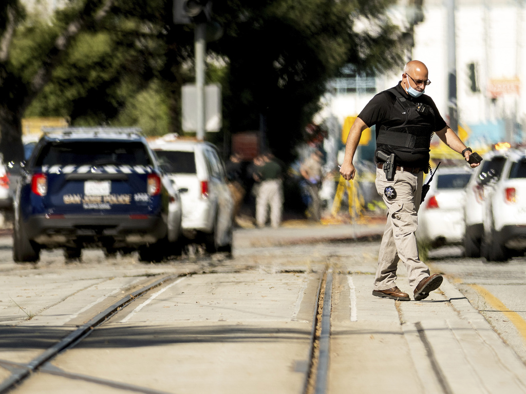 Law enforcement officers respond to a mass shooting at a Santa Clara Valley Transportation Authority facility on Wednesday in San Jose, Calif. Santa Clara County sheriff's spokesman said the rail yard shooting left multiple people, including the shooter, dead.