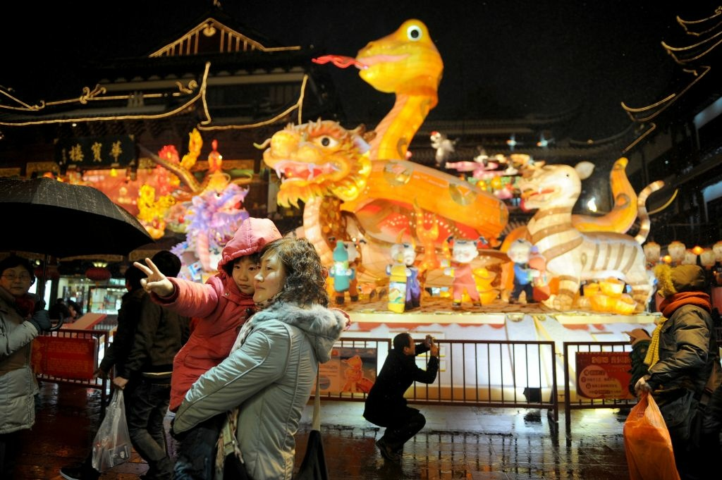 Visitors look at a display celebrating Chinese lunar new year in Shanghai on February 8, 2013. Preparations continue in China for the Lunar New Year which will celebrate the Year of the Snake on February 10.