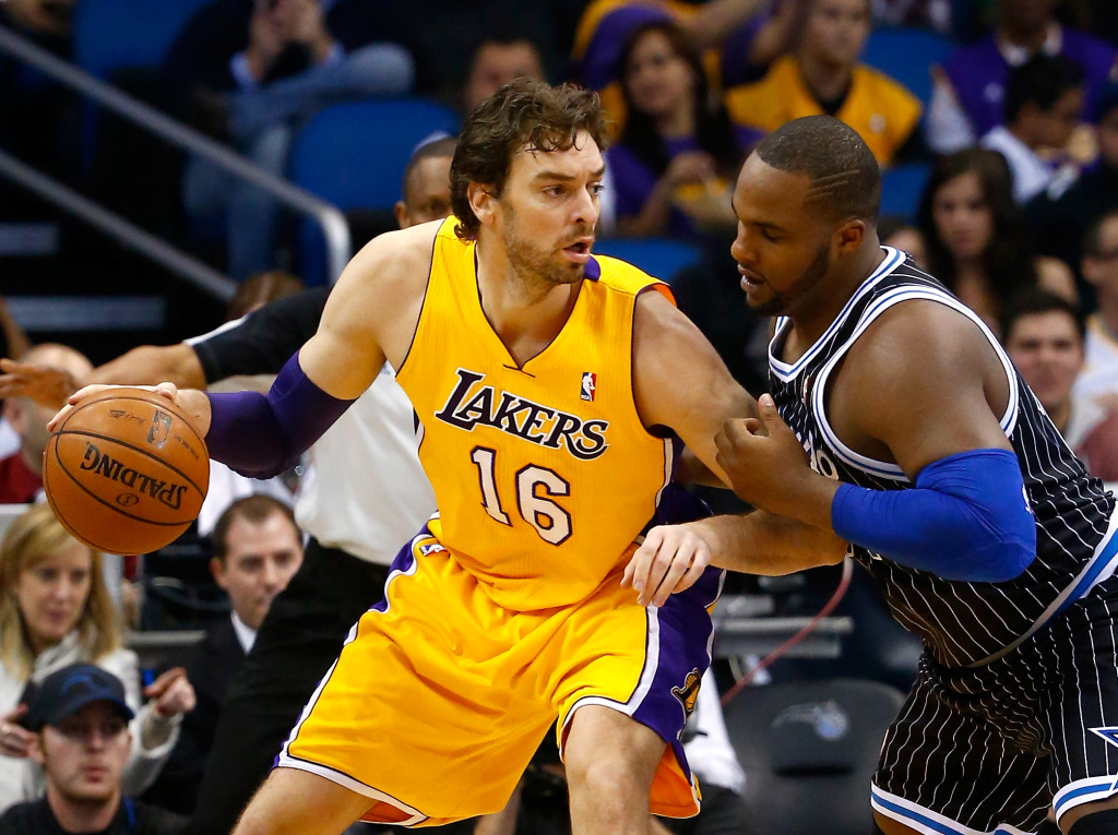 Glen Davis #11 of the Orlando Magic gaurds Pau Gasol #16 of the Los Angeles Lakers during the game at Amway Center on January 24, 2014 in Orlando, Florida.