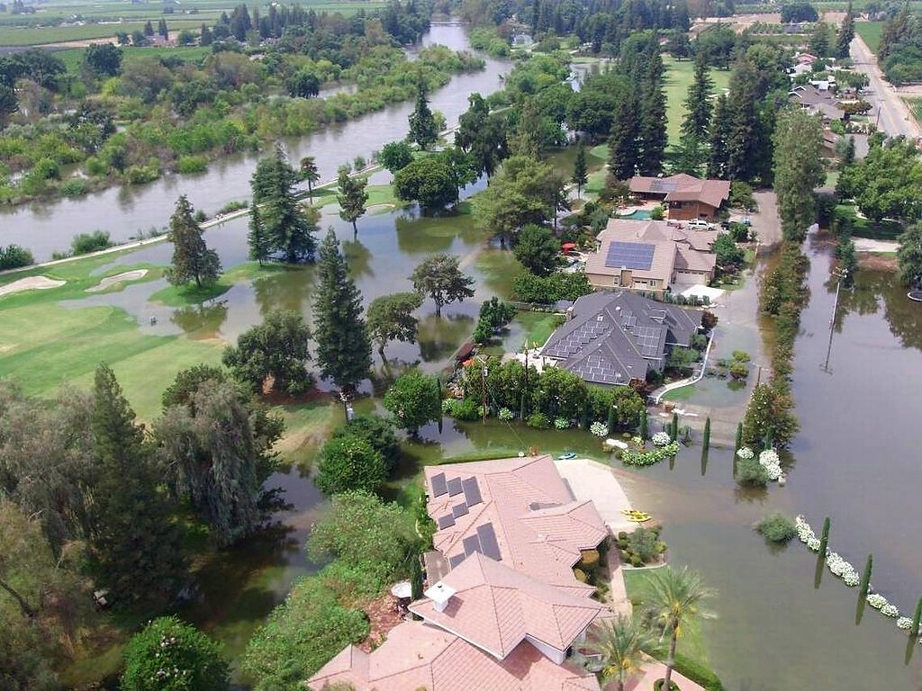 This June 25, 2017, photo taken by an unmanned aerial vehicle and released by the Tulare County Sheriff's Office shows flooding from the Kings River at the Kings River Golf and Country Club in Kingsburg, Calif. The Kings River began to flood about 25 miles (40 kilometers) north of Fresno as temperatures soared, melting snow in the Sierra Nevada and sending it downstream.
