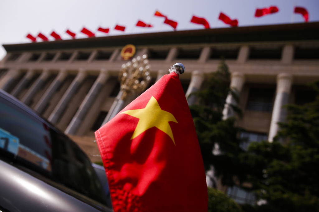 BEIJING, CHINA - MAY 12: The Vietnamese national flag flies on a diplomatic car outside the Great Hall of the People before talks between Vietnam's President Tran Dai Quang and Chinese leaders on May 12, 2017 in Beijing, China. (Photo by Thomas Peter - Pool/Getty Images)