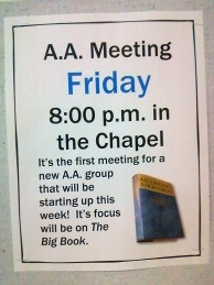 A posted sign announcing an Alcoholics Anonymous meeting.