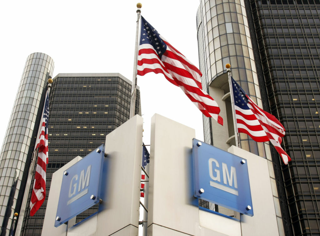Signs stand in front of the General Motors world headquarters in Detroit, Michigan. The U.S. Treasury will sell its remaining stake in the company over the next year or so.