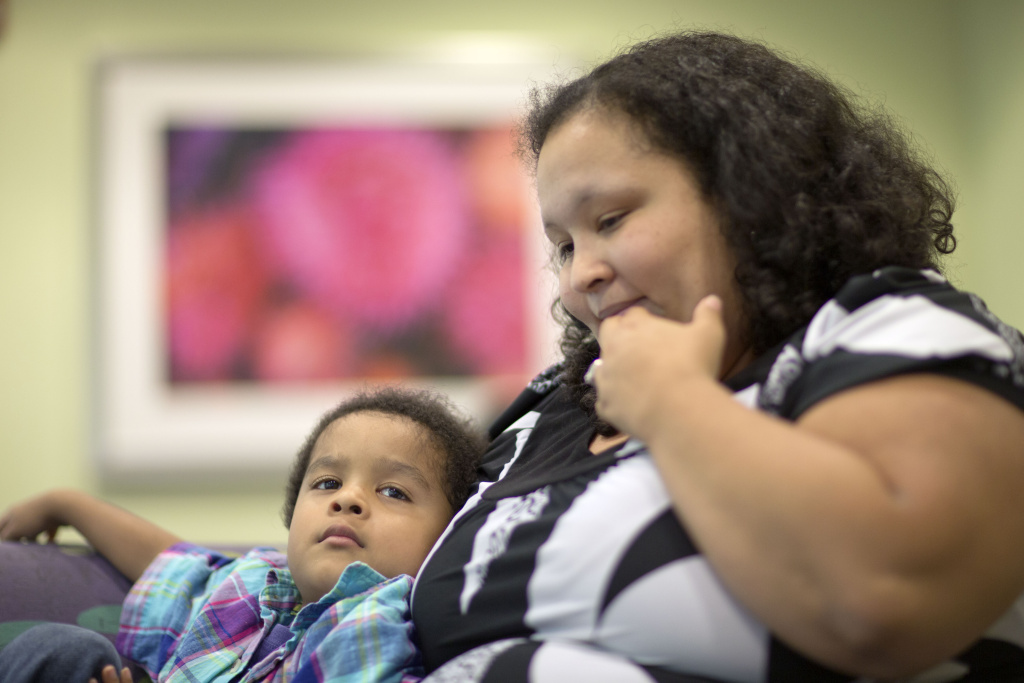 Marlaina Dreher, right, sits with her 5-year-old son, Brandon, who is autistic, before a session in the pediatric feeding disorder program at the Marcus Autism Center, Wednesday, Sept. 18, 2013, in Atlanta.