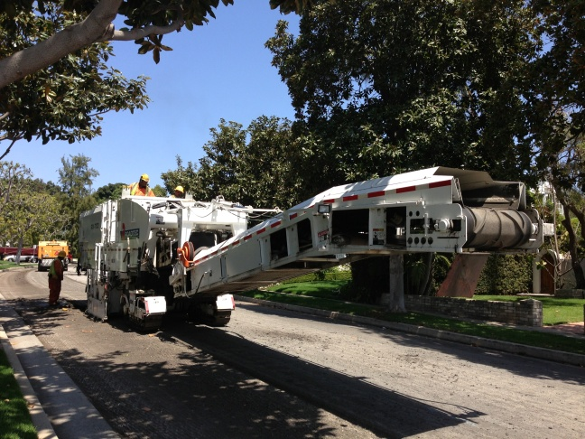 The profiler is used by the Bureau of Street Services to prepare a street for repaving.