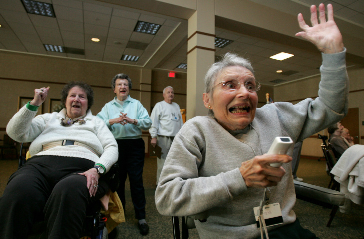 Jeanne Gildea (R), 81, reacts to a shot