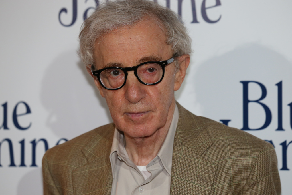 US film director Woody Allen poses during a photocall for the French Premiere screening of 'Blue Jasmine', his latest movie, on August 27, 2013 in Paris.